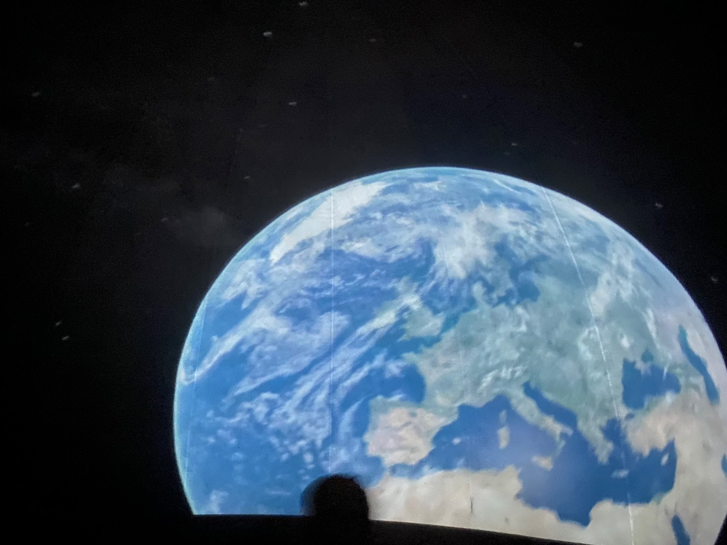 View of Earth from space projected inside the planetarium dome.