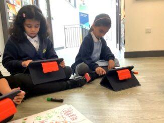 Oasis pupils using iPads